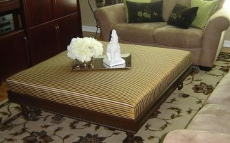 Modern coffee table in extra large size with strips patterned surface and darker brown wooden base