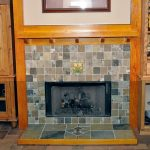 Modern fireplace mantel with ideal height built in storage beside the fireplace mantel