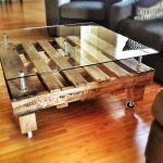 Modern rustic coffee table idea with frameless and transparent glass top table and wood plank base and also wheels