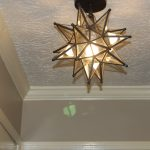 Moravian Star Pendant Light On White Ceiling With Art Design