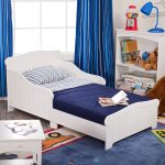 Nantucket-blue-toddler--bed-by-kidkraft-from-strong-and-durabe-rubber-wood-with-smooth-white-lines-and-regular-crib-mattress