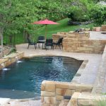 Natural Rectangular Pool WIth Rustic Ceramic And Pool Chairs