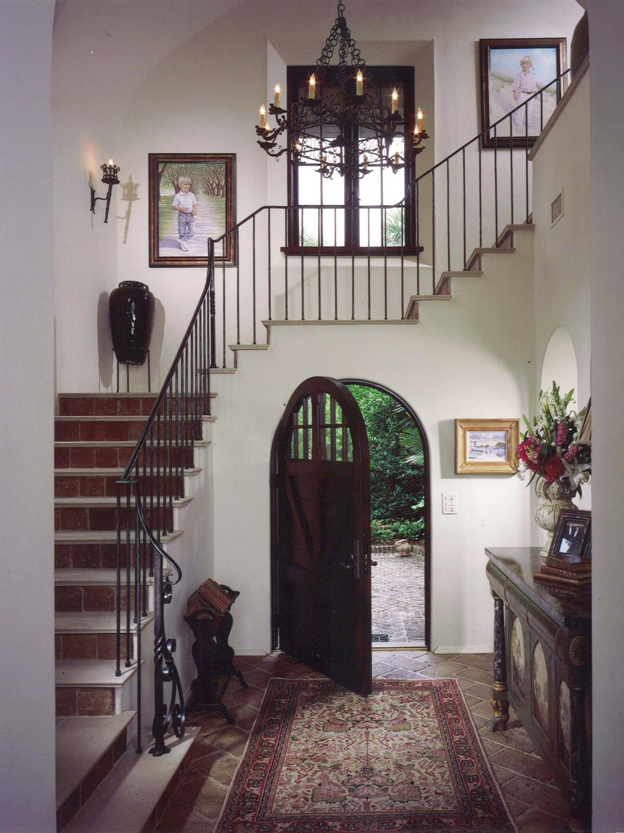 Neautral Spanish Design On Entrance And Stairs With Cool Rug Chandelier And  Wooden Cabinet. Spanish Living Room ...