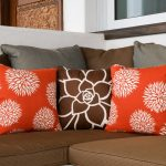 Neutral pillows and cheerful colors with floral patterns