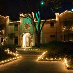 Outdoor Christmas Lighting Decoration In Front Of The House And Around The Landscape