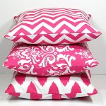 Pink accent pillows in different patterns