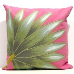 Pink throw pillow with green floral motif as the ornament