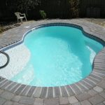Pool With Fiberglass Style ANd Stone Tiling