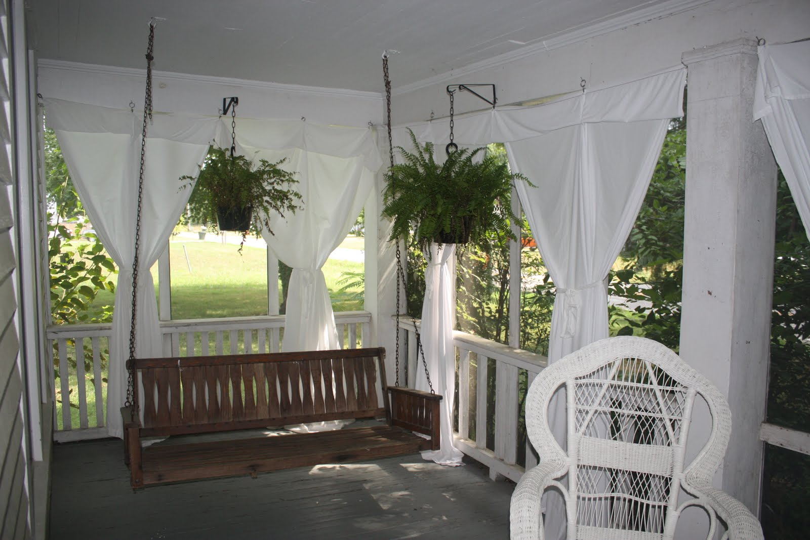Pure White Draperies For Outdoor A Wooden Hang Bench With Backrest Feature  A White Rattan Chair