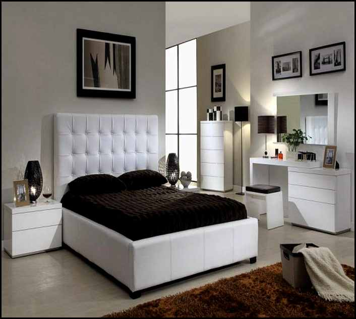 Quuen Sized Bed Furniture With Higher White Leather Headboard Dark Brown  Bedding And Dark Brown Pillows