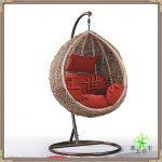 Rattan Chair With Orange Pillows