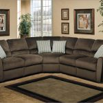 Reclining sectional furniture set in black and microfiber material some throw pillows with strip pattern