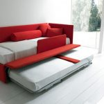 Red loveseat sleeper with additional movable trundle