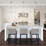Restoration Hardware Carmel Barstool In Modern Kitchen With Grey Chairs And Hardwood Floor Beautiful Chandeliers