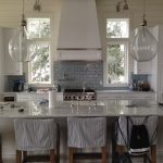 Restoration Hardware Counter Stool In White And Grey Kitchen With Wooden Chairs Big Lamps And Square Windows