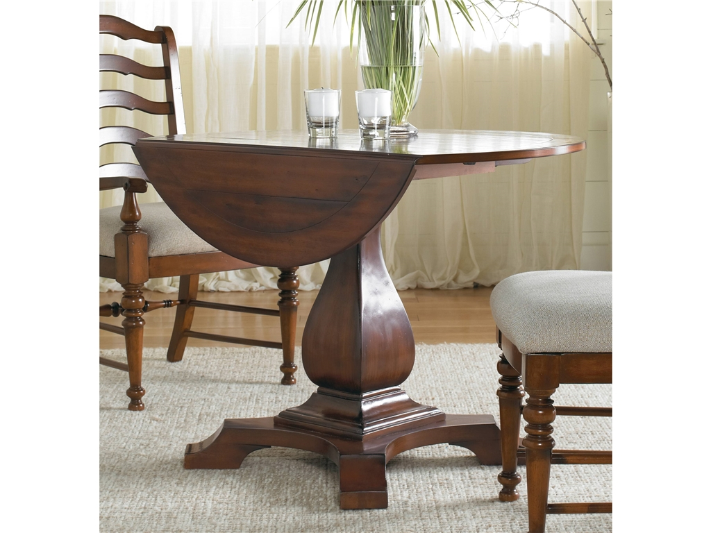 Round Drop Leaf Table With Single Leaf Made From Solid Wood A Pair Of Wood  Chairs