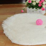 Round white fluffy rug a wool string ball in pink color