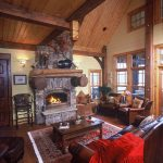 Rustic Interior Mountain Home Design In Living Room With Stone Fireplace Wooden Table Brown Couches And Stylish Rug