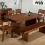 Rustic styled wooden dining furniture set with bench a bar cabinet unit for storing the wine