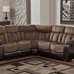 Simple and small reclining sectional with black leather at base and microfiber at top a rattan box as magazine holder an area rug with modern pattern