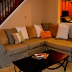 Slipcover idea for sectional with single chaise  with a lot of throw pillows black coffee table