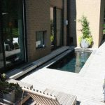 Small Cool Backyard Pool With 2 Pool Chairs