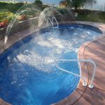 Small Fiberglass Pol With High Water Fountain And Pool Deck
