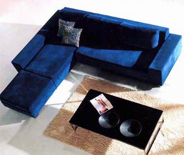 small lshaped sectional with chaise in blue navy a pair of decorative pillows black