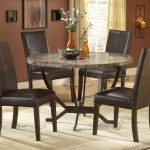 Small Round DInette Set With 4 Dark Brown Chairs And Large Rug