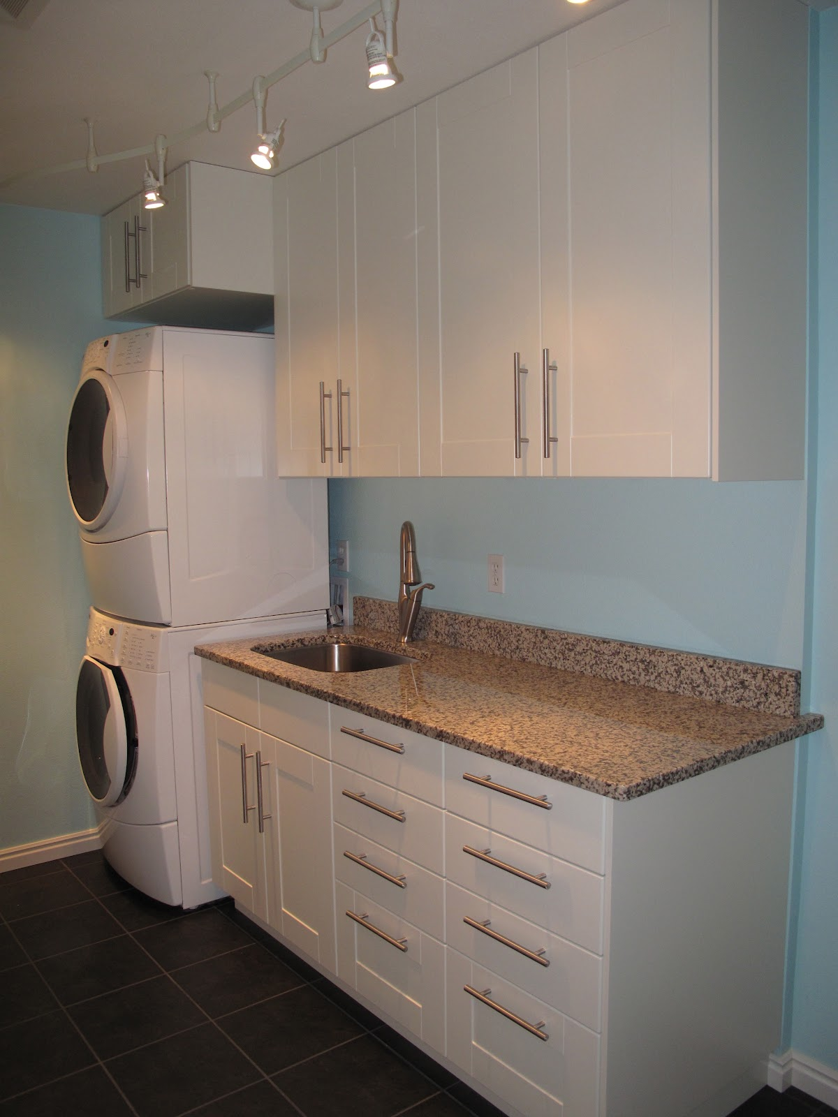 Small Cabinet System With Granite Countertop And Sink Plus Faucet For A  Laundry Room A Washing