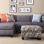 Small size  sectional furniture set with chaise and some throw pillows an ottoman with floral pattern as the coffee table brown jute area rug a modern standing light fixture