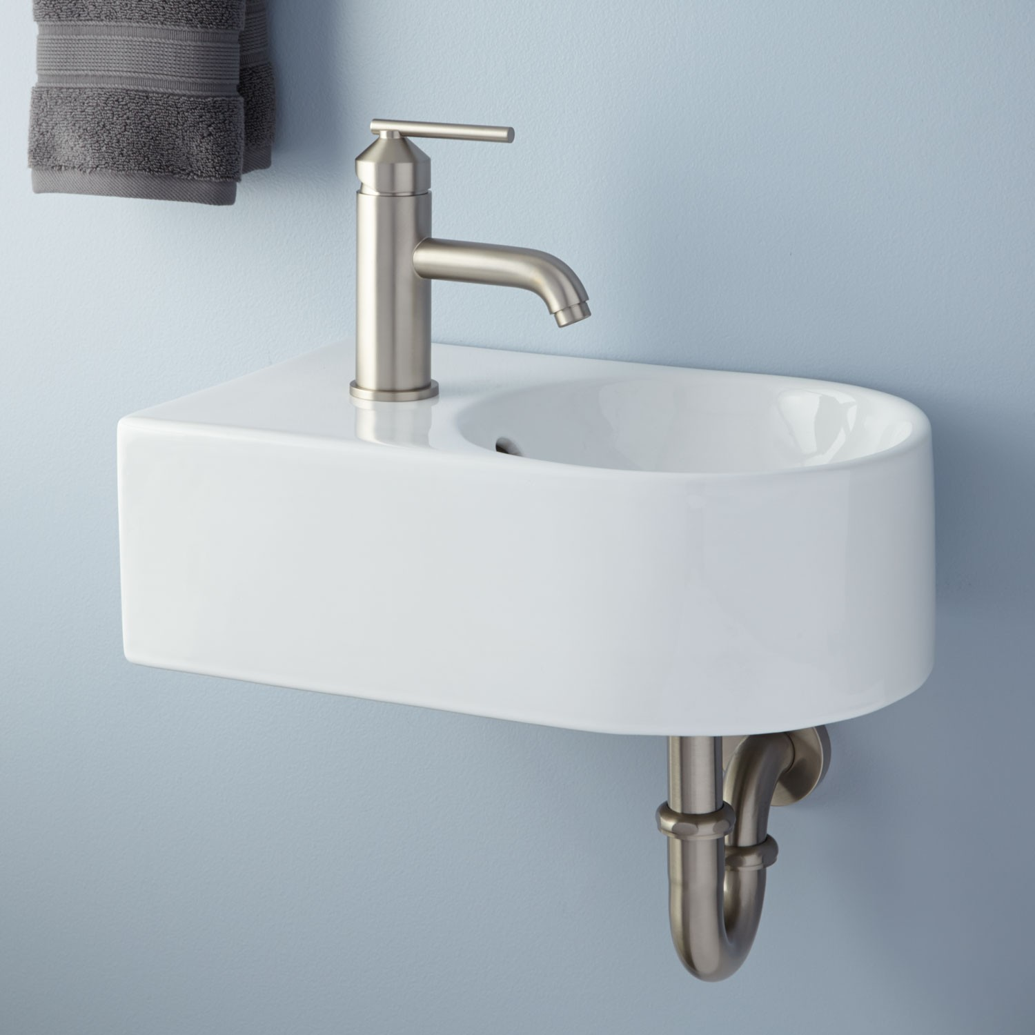 Small wall mounted bathroom sinks - Small Wall Mounted Sink Idea With Brushed Iron Faucet