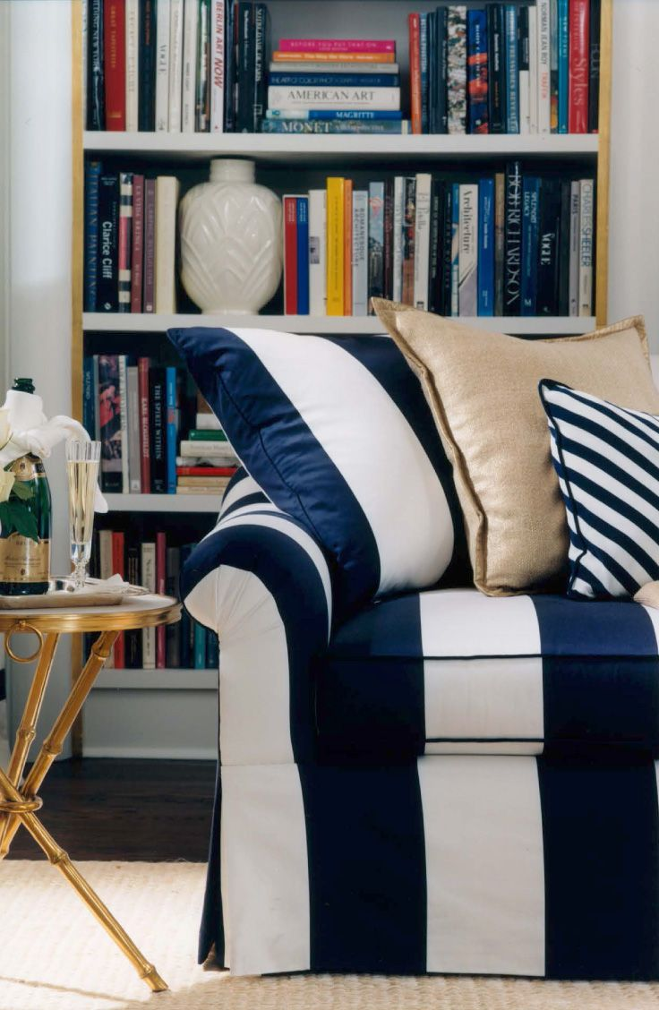 Striped White And Black Couch With Piilows Bookcase