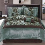 Superking bed with black leather headboard  glossy teal and brown duvet bedding idea with similar tone colored pillows