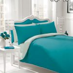 Sweet teal bedding set for white bed frame with white framed teal headboard pure white bedside table in classic style a modern table lamps a white vase with flowers