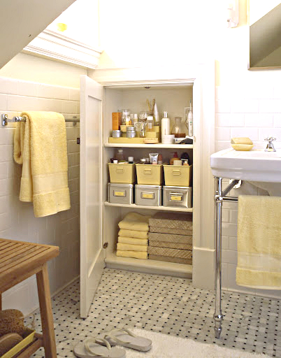 tall bathroom cabinet organizer with yellow stoarge boxes as the