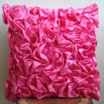Textured pink accent pillow for indoor and outdoor furniture