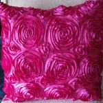 Textured pink flower accent pillow