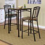 The-Cabin-Creek-bistro-table-by-Home-Styles-with-hardwood-solids-and-veneers-in-a-heavily-distressed-multi-step-and-chestnut-finishing-with-pop-corn-and-beers