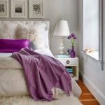 Thick and fluffy white bedroom rug fluffy white pillows bright purple pillow a side table for bed