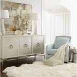 Thick And Soft White Fluffy Rug Idea An Armchair A Credenza With Artistic Metal Handles A Pair Of Table Lamps An Abstract Painting As Wall Decoration
