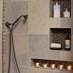 Three units of built in shower shelves ideas with ceramic mosaic tiles at the back a heldhand showerhead
