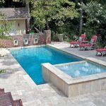 Triple Water Fountain Of Pool With Awesome Style And Red Pool Chairs