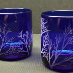 Two-Cobalt-Blue-Tumbler-Drinking-Glasses-with-Hand-Engraved-With-'Reaching Branches'-and-used-as-candle-holders-too-and-no-acids-chemical-sand-blasting-or-laser-to-create-the-engravings