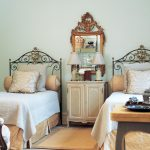 Two Small Decorative Bed With Its Pillows Classic Mirror Above Small Cabinet