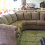U Shaped Sectional With Pillows And Decorative Rug
