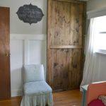 Unique Wooden Sliding Door Closet In Bedroom Near White Chair