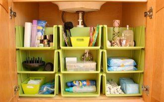 Unique additional green plastic shelves inside a wooden bathroom closet organizer