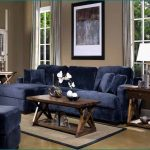 Velvet blue navy sectional with chaise x base wooden coffee table in rustic style x base wood side table in rustic style medium sized jute rug with black frame
