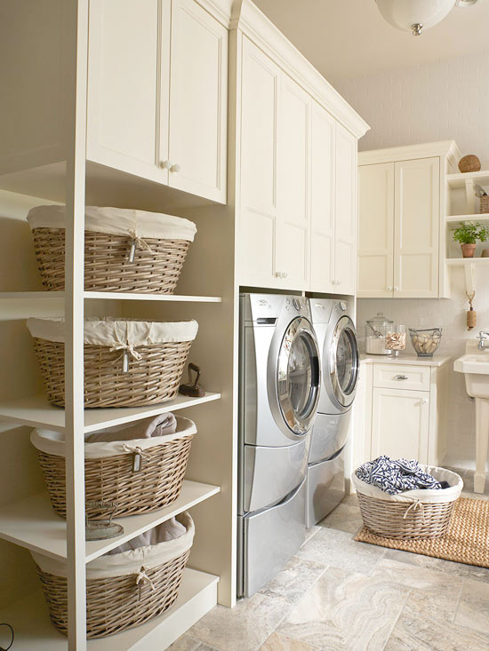 Vertical shelves with rattan basket storage units upper white cabinet system  a washer machine a dryer
